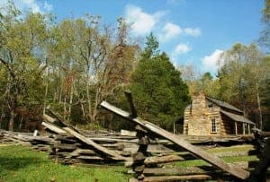 historic log cabin and split rail fence in Cades Cove