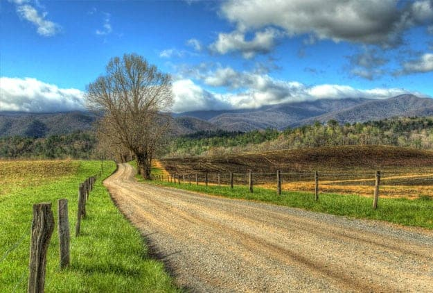 Quiet country lane with beautiful view of Smoky Mountains in Cades Cove